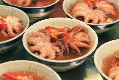 Red octopus in a plate