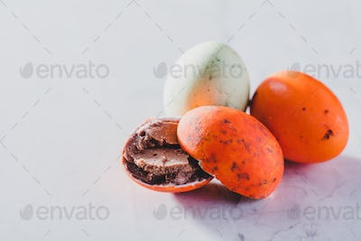 Three colorful chocolate eggs on a white background.