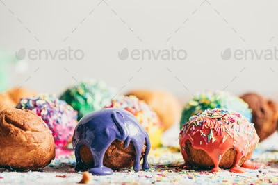 Decorated doughnuts on a kitchen counter.