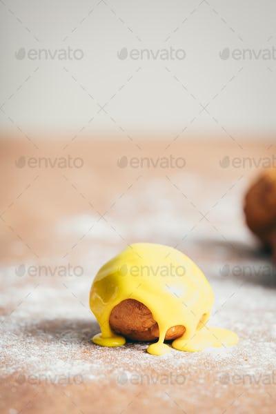 Single doughnut with vivid yellow icing