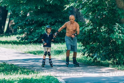 Roller skating in the park with grandfather
