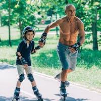 Grandfather and grandson roller skating together
