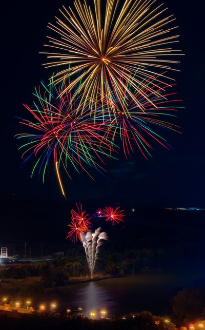 fireworks on the banks of river photographed from atop