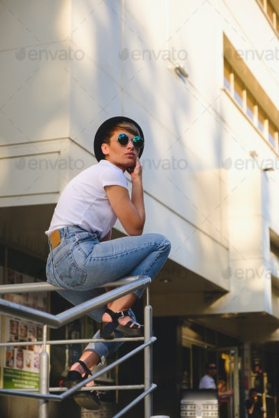 Modern woman portrait wearing stylish round glasses hanging out
