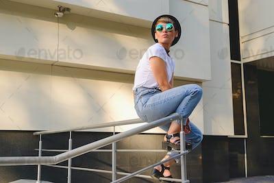 Modern woman portrait wearing stylish round glasses hanging out