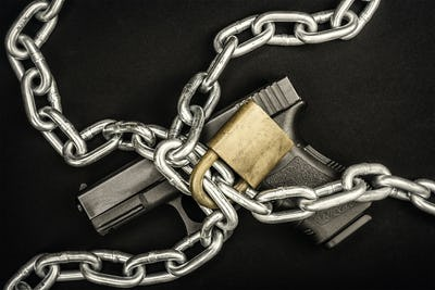 Chained up handgun