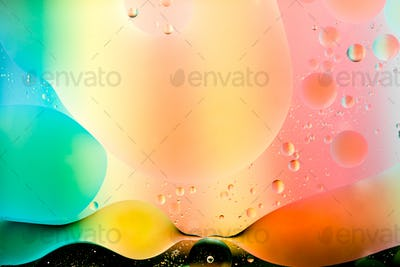 oil mixed with water on colorful background