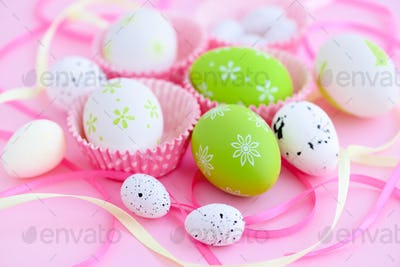Festive background with easter eggs and ribbons