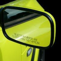 Yellow sports car mirror