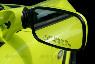 Yellow sports car mirror