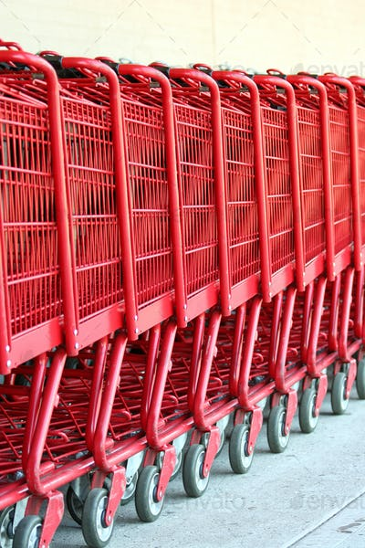 Row of red metal shopping carts