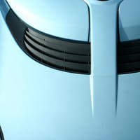 Blue sports car hood with scoop
