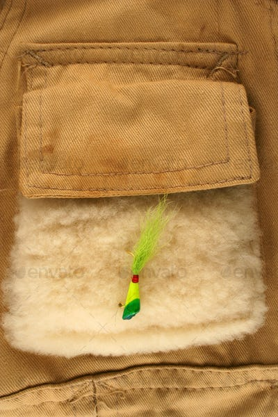 Fishing lure on a vest pocket