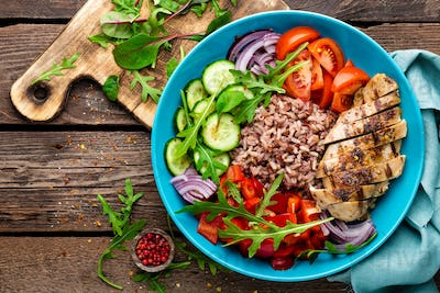 Grilled chicken breast with rice and salad