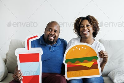 Black couple with food icon