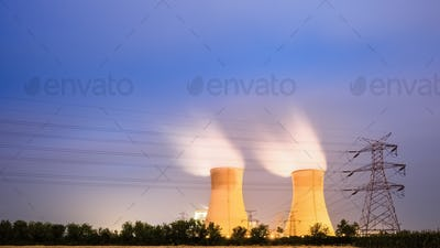 cooling tower of power plant at night