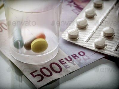 Some medicines along with a ticket of 500 euros, conceptual image copay health