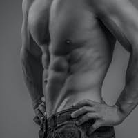 Perfectly fit shirtless young man