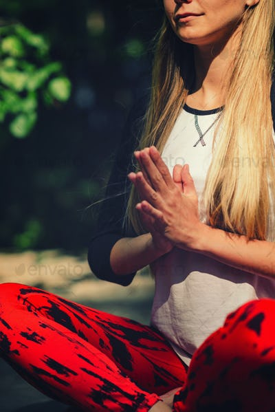 Meditation. Positive young woman meditating outdoors
