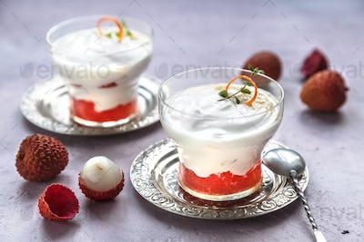Lychee dessert with grapefruit on pink background