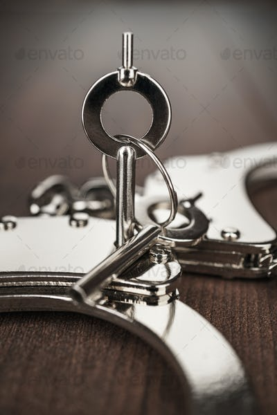 Close-up Handcuffs And Keys