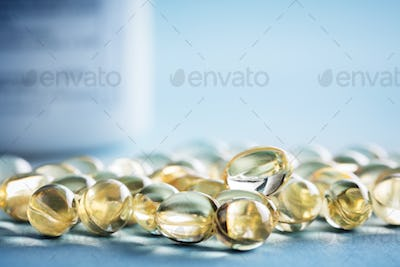 Vitamin D laying on the table. Supplements.