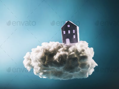 Paper house standing on the cotton cloud