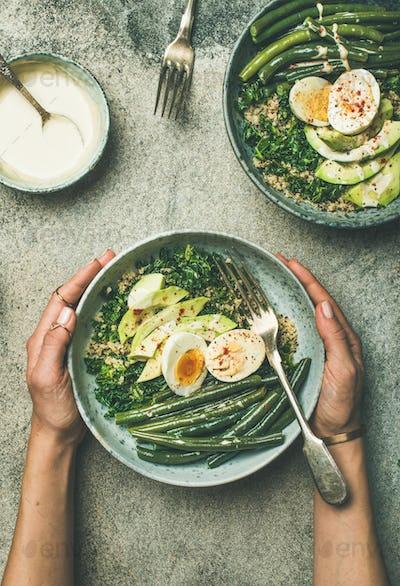 Quinoa, kale, green beans, avocado, egg bowls flat-lay, vertical composition