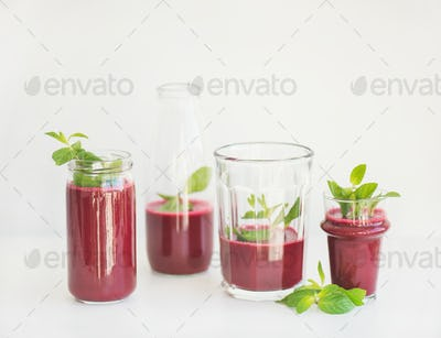 Fresh morning beetroot smoothie or juice in glasses with mint
