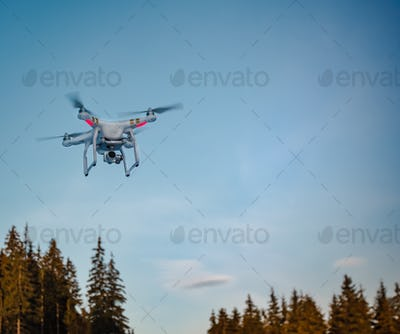 Modern Remote Control Air Drone Fly high in sky