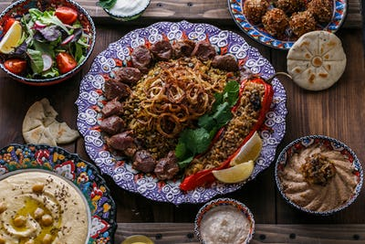 Middle eastern or arabic dishes: shish kebab, falafel, hummus, rice, tahini, kashke bademjan, pita