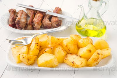 pan fried whole potatoes on white wooden table