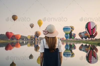 Young woman traveler looking view of the flying balloons