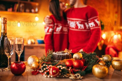 Table with christmas decor, couple on background