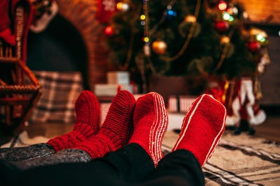 Couple feet in merry red socks, christmas