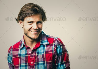 caucasian man wearing checkered shirt and trendy hairstyle