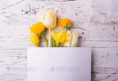 Easter and spring flat lay on a white wooden background.