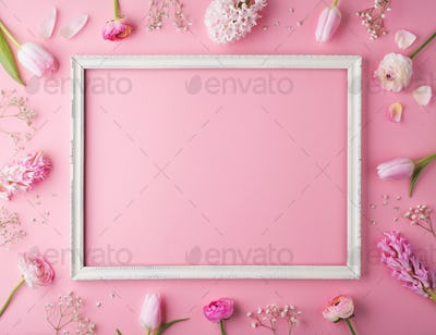 Easter and spring flat lay on a pink background.