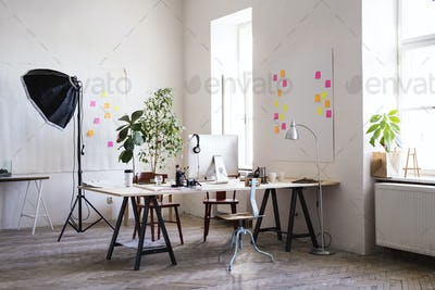 The interior of an empty modern office or a studio.
