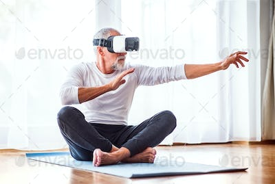 Senior man with VR goggles doing exercise at home.