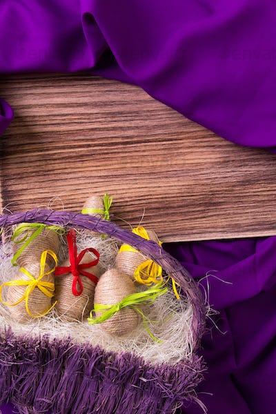 Easter. White eggs in purple basket