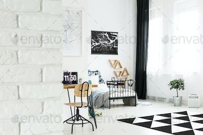 Spacious bright bedroom with workspace
