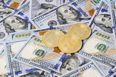 Golden Bitcoins on American dollars