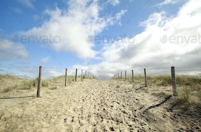 path on sand and blue sky