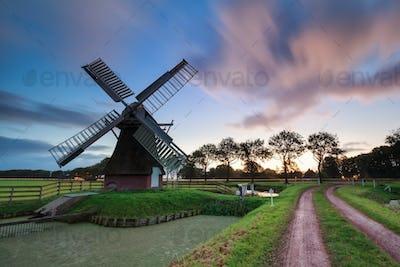 sunrise over Dutch windmill in summer