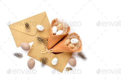 Waffle Cones with Easter Eggs with envelopes on white background