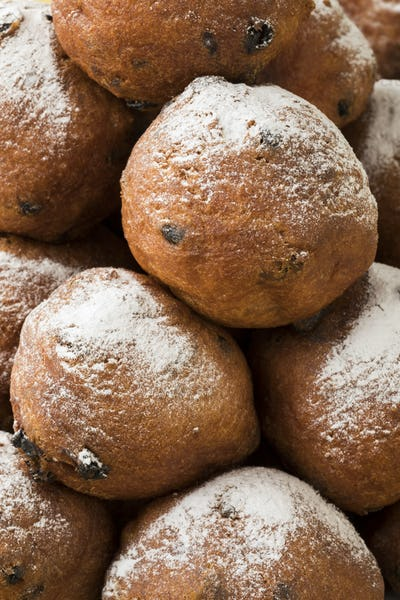 Heap of oliebollen,close up, traditional Dutch pastry for New Ye