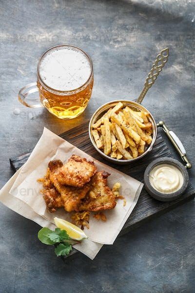 British Fish and chips with beer on dark background