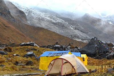 Expedition tents in the Annapurna Base Camp, Himalaya mountains, Nepal in a cloudy day