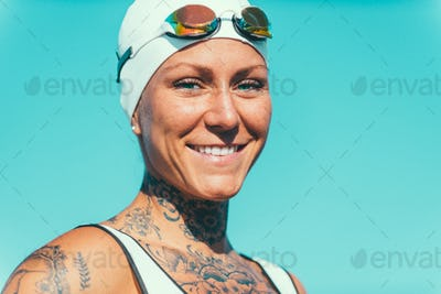 Portrait of female swimmer with tattoos